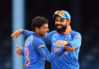 Virat Kohli and Kuldeep Yadav celebrate a...