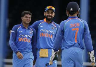 Kuldeep Yadav celebrates fall of wicket with...