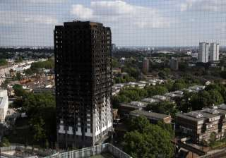 The remains of Grenfell Tower stand in London -...