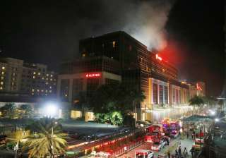 At least 36 killed after gunman sets fire to...