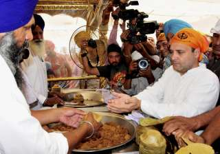 Rahul Gandhi receiving 'parsada' durinh a visit...