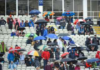 Spectators waiting for the rain to end in...