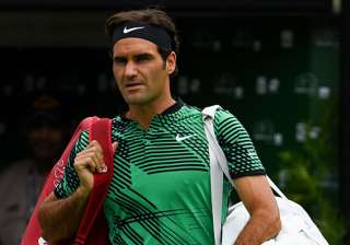 Roger Federer of Switzerland walks onto the court...