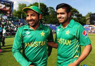 Sarfraz Ahmed celebrates with Babar Azam after...