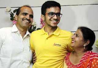 IIT-JEE topper Sarvesh Mehtani with his parents ...