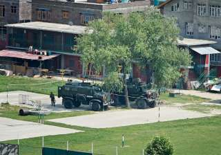 Srinagar: Bullet proof vehicles stationed in the...