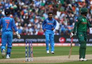 Tamim Iqbal of Bangladesh walks as he is bowled...