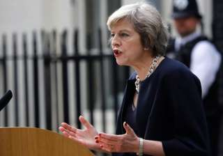 File pic of British Prime Minister Theresa May -...