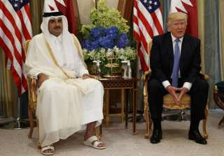 Trump in a bilateral meeting with Qatar's Emir in...