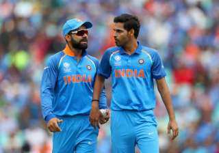 Virat Kohli and Bhuvneshwar Kumar of India chat...