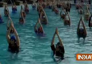 1000 women practice water yoga - India TV