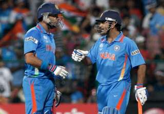 Yuvraj Singh and MS Dhoni during a match` - India...