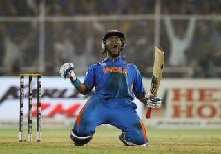Yuvraj Singh of India celebrates after hitting...