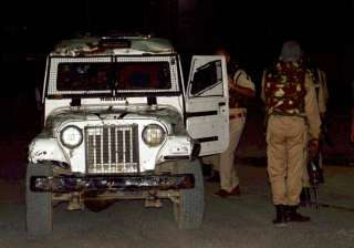 Security personnel after militants opened fire on...