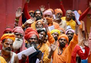 Jammu: Sadhus wait in a queue to register...