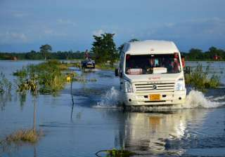 People travel in a mini bus at flood-hit Jamlai...