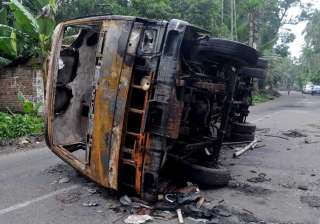 A burnt vehicle seen at a road after a communal...