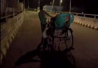 Family carries body on rickshaw after being...