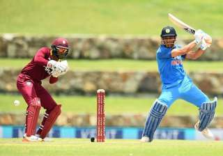 MS Dhoni plays a shot against West Indies. -...