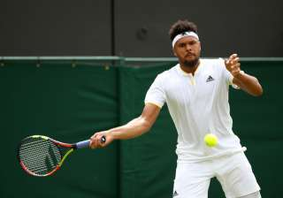 Jo-Wilfried Tsonga of France plays a forehand -...