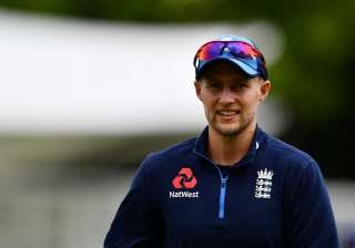 Joe Root of England looks on during an England...