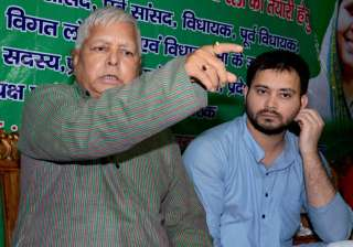 Lalu Prasad addressing a press conference with...