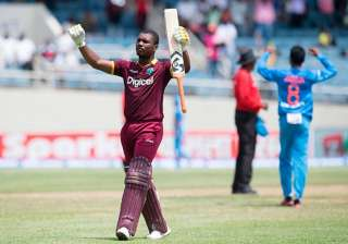 Evin Lewis reacts after reaching to his hundred....