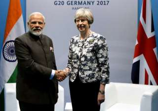 PM Modi meets Theresa May in Germany - India TV