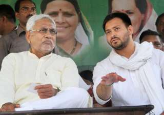 File pic - Nitish and Tejaswi at an event -...