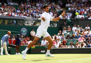 Novak Djokovic of Serbia plays a forehand during...