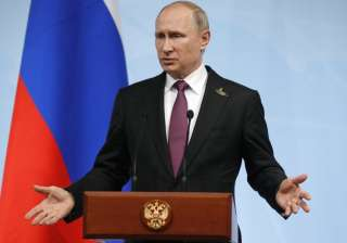 Putin gestures during a press conference after...
