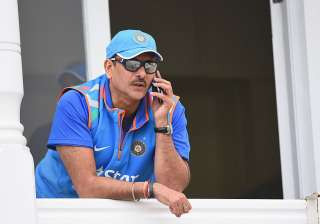 Ravi Shastri of India speaks on the phone during...
