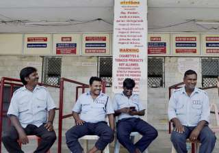 Guards sitting near the ticket counter of a...