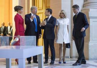 Trump, Macron and their wives chatting after...