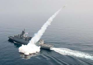 A South Korean navy ship fires a missile during...