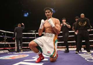 Vijender Singh reacts after winning the fight -...