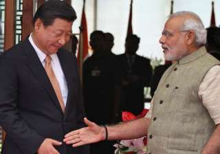 File pic of Xi Jinping and Narendra Modi - India...