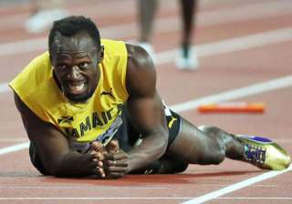 Usain Bolt bows out with injury in last race -...