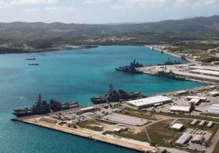 File Navy vessels moored in port at the U.S....