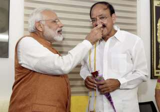 PM Modi offers sweets to VP-elect Venkaiah Naidu...