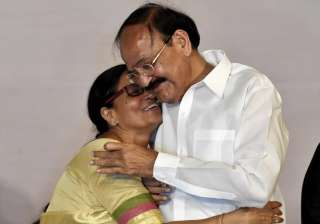Venkaiah Naidu and his wife Usha after being...