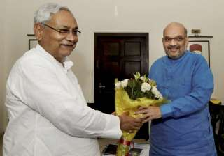 Nitish Kumar greets Amit Shah in a meeting at the...