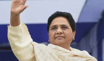BSP supremo Mayawati waves at crowd at a rally at...
