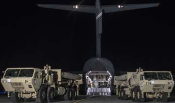 Trucks carrying missile launchers and other...