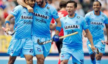 Indian hockey team wear black arm bands to...