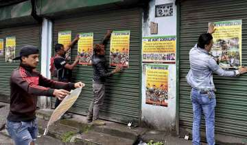 GJM activists paste party posters during...