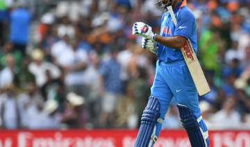 Shikhar Dhawan of India leaves the field - India...