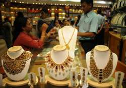 gold declines by rs 180 silver gains rs 225