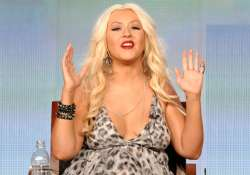 christina aguilera appears bra less to promote talent hunt