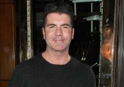 cowell supports charity tea party